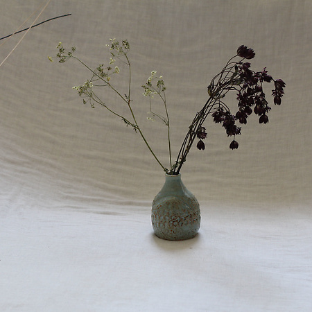 Vases and other flower beautifiers
